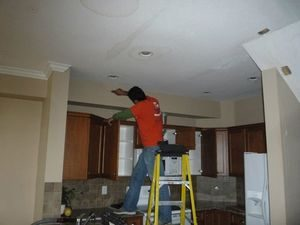 Water damage Holt Technicians repairing ceiling
