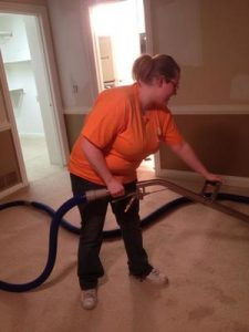 Water damage Holt Technician vacuuming up water