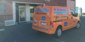 Water Damage and Mold Removal Van At Commercial Job Site